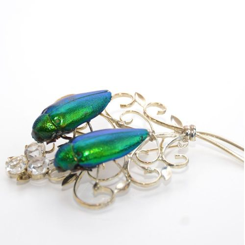 Emerald beetle brooch twin. Silver plated with stones